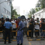 Protests outside parliament as parties face off