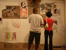 Gallery-goers admire the artworks