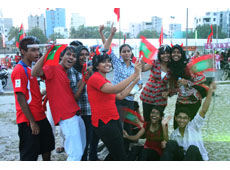 Young Maldivians dressed in red to support their team