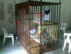 A prison cage at Gan