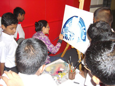 Demonstrating painting to visitors