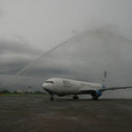 Bodu beru dancers and water cannon salute welcome first scheduled flight from Seoul