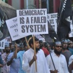Protesters march with IS flag calling for enforcement of Islamic Shariah
