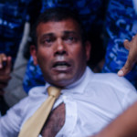 Former President Nasheed appears in court with arm in makeshift sling