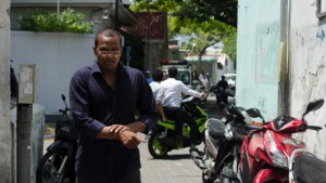 MP Falah rubs wrists after being handcuffed